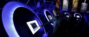 A visitor uses a touchscreen inside a dome during a European Space Expo, running under the auspices of the European Commission in Athens' Syntagma Square, March 28, 2015. REUTERS/Kostas Tsironis